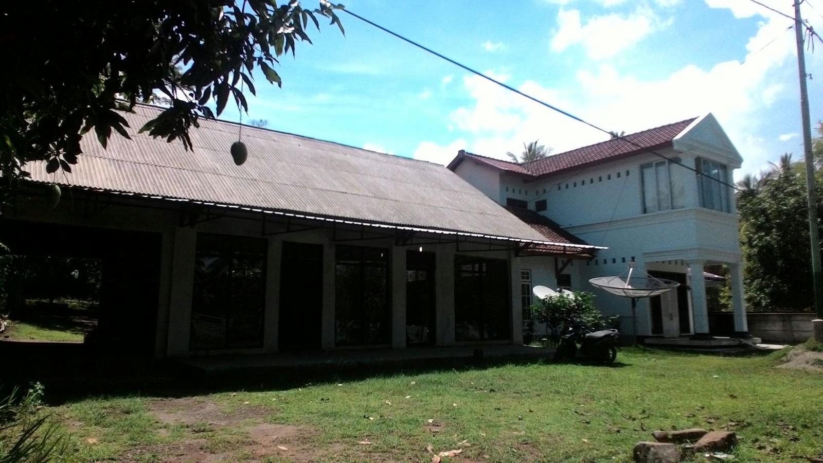 Sebuah rumah di Dusun Cupek, Sigar Penjalin.