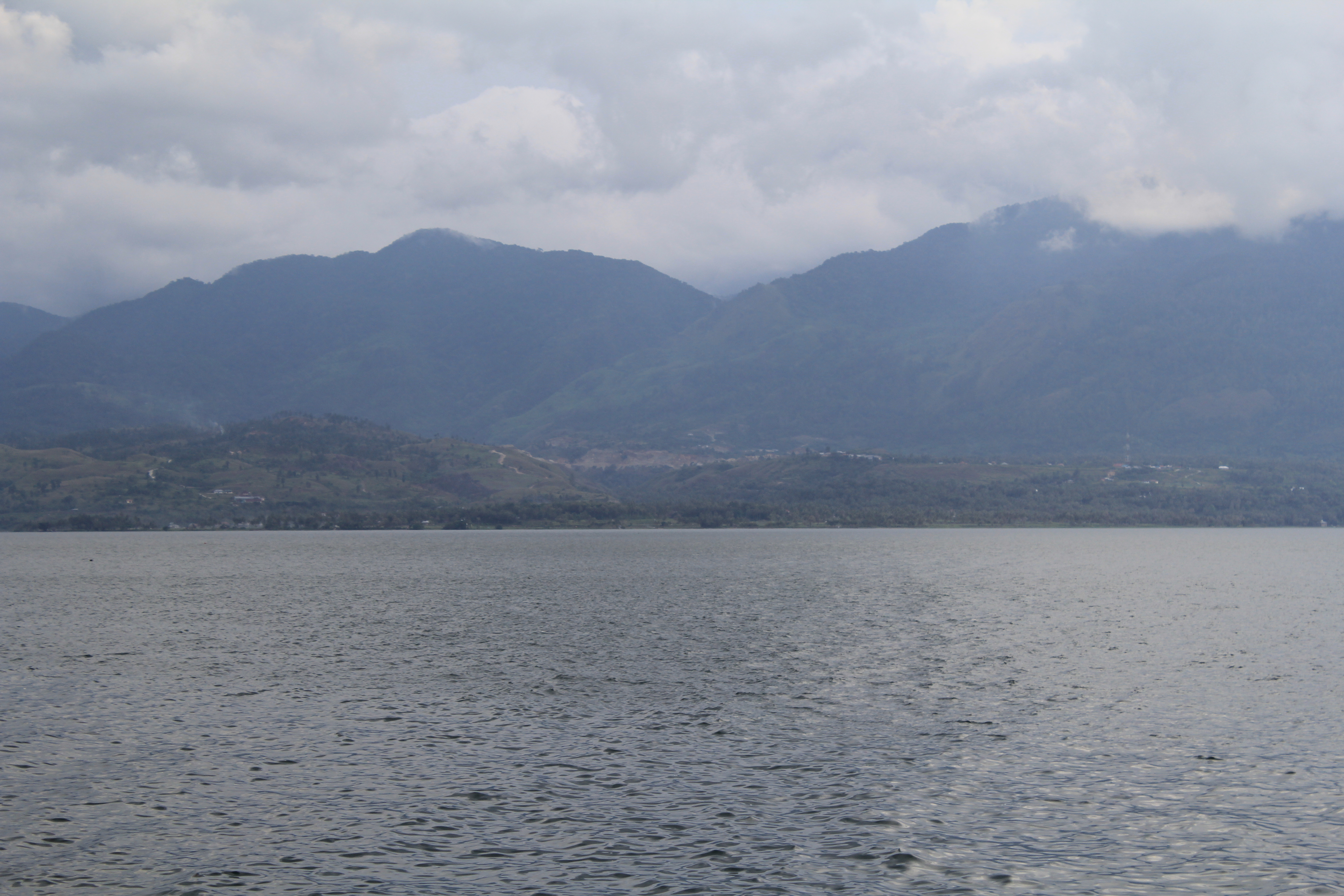 Lokasi tambang, tampak dari seberang Danau Singkarak.